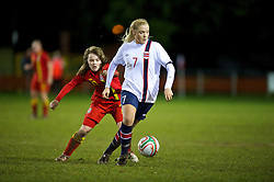 NEWTOWN, WALES - Friday, February 1, 2013: Norway's Marit Sandtroen and Wales' Ellie Curson during the Women's Under-19 International Friendly match at Latham Park. (Pic by David Rawcliffe/Propaganda)