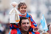 Vatican City oct 18, 2015, holy mass with canonizations in St Peter's Square. In the picture argentinian pilgrims: a child dressed as a swiss guard, with a pope puppet