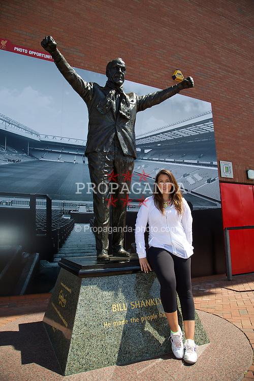 LIVERPOOL, ENGLAND - Saturday, June 21, 2014: Wimbledon champion Marion Bartoli at the statue of Bill Shankly on a visit to Anfield during Day Three of the Liverpool Hope University International Tennis Tournament. (Pic by David Rawcliffe/Propaganda)