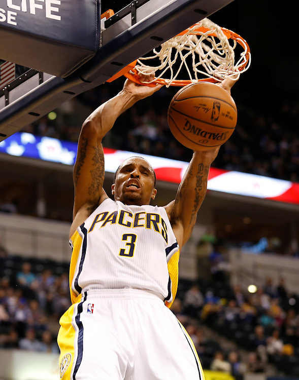 Indiana Pacers' George Hill dunks the ball against the Dallas Mavericks at Bankers Life Fieldhouse Saturday October 18, 2014.