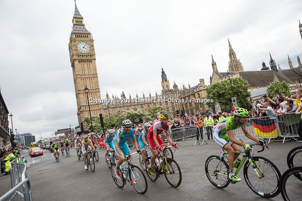 Image ©Licensed to i-Images Picture Agency. 07/07/2014. London, United Kingdom. Tour de France in Central London. Tour de France riders pass the Big Ben in Central London as part of the last stage of the tour occurring in the United Kingdom Tour de France 2014. Parliament Square. Picture by Daniel Leal-Olivas / i-Images