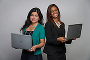 Elvira Salazar, left, and Brittany Lewis, right, pose for a photograph, October 17, 2014.