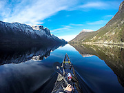 Pining for the fjords! Kayaker captures breathtaking Norwegian landscapes from the water... and gains 10,000 Instagram followers<br /> <br /> Would you believe that these breathtaking photos were seen through the lens of a kayaker's GoPro camera?  <br /> Intrepid Tomasz Furmanek spends his spare time away from the Institute of Marine Research gliding atop the waters in some Norway's most idyllic beauty spots.<br /> For 10 years, Tomasz, a software developer, has visited many of the fjords in western Norway, inland lakes and the areas around Lofoten Islands in the northern part of the country.<br /> <br /> But for Tomasz the main reason he has spent so much time kayaking is because he finds it relaxing.<br /> He said: 'I kayak mainly because it is an easy way to get mental balance.<br /> 'You get close to nature in a kayak and can experience things that is not possible while hiking.'<br /> <br /> For the past two years, Tomasz has been documenting his trips and uploading what he calls an 'adventure blog' to his 10,000 followers on Instagram.<br /> 'I do not upload private pictures,' said Tomasz.<br /> 'The Instagram feed is more an adventure blog than a personal profile.<br /> 'The people that follow my account are mainly interested in kayaking, although I have some followers that do not do kayaking.<br /> <br /> 'I had about ten thousand followers this summer before I went to Lofoten with Kristoffer Vandbakk who I met on Instagram.<br /> 'After three weeks of kayaking in Lofoten area, I gained about ten thousand new followers.'<br /> Tomasz mainly uses a helmet mounted GOPRO3+ camera for photos and videos and a Sony RX100mk2 in a waterproof box on the front deck of the kayak. <br /> ©Tomasz Furmanek/Exclusivepix Media