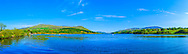 View of overlooking Camlough lake from its northern shore, flanked by Camlough mountain on the left and Slieve Gullion on the right, with the Cooley mountains off in the far distance.<br />