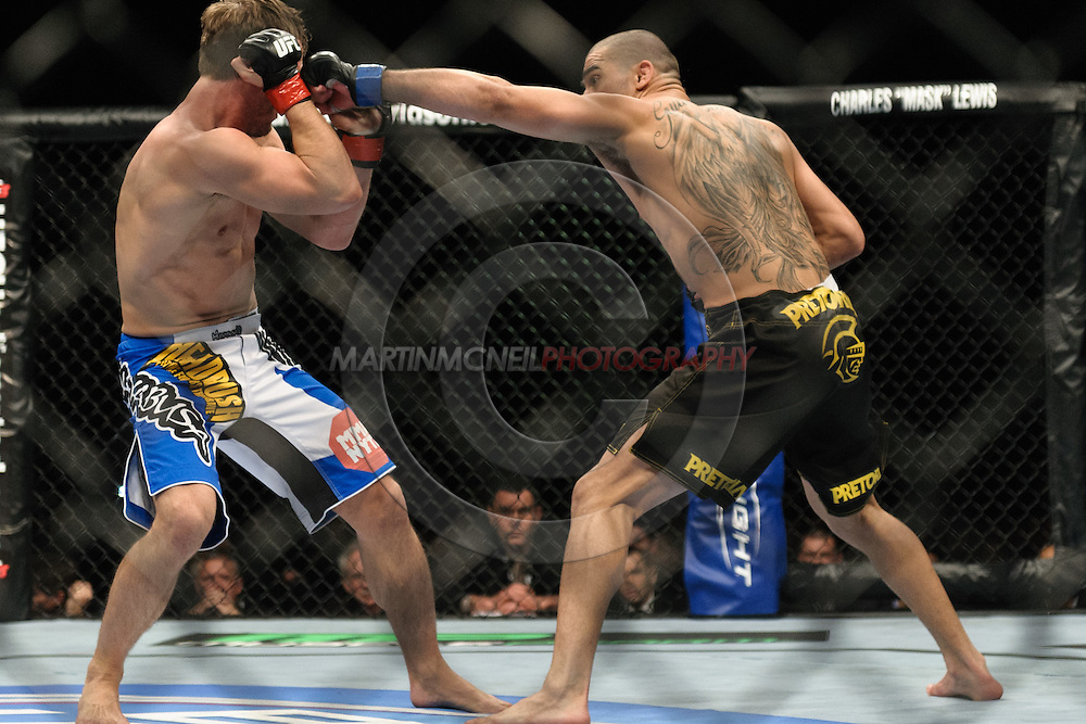 "BIRMINGHAM, ENGLAND, NOVEMBER 5, 2012: Brad Pickett (left) slips a punch from Renan Barao during ""UFC 138: Munoz vs. Leben"" inside the National Indoor Arena in Birmingham, United Kingdom"