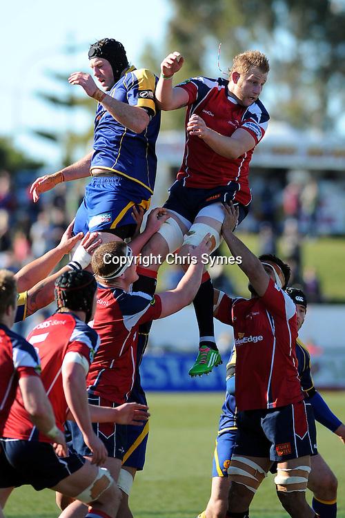 Otago`s Tom Donnelly(L) and Makos Mark Bright during the ITM Cup game Tasman Makos v Otago. Trafalgar Park, Nelson, New Zealand. Sunday 21 August 2011. Photo: Chris Symes/www.photosport.co.nz