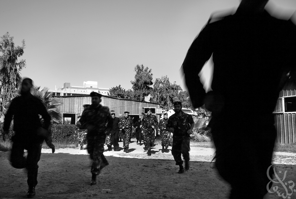 HAMAS border police trainees quickly flee their base December 22, 2009 at the City of Arafat Police headquarters in Gaza City, Gaza following an overhead flight by an Israeli fighter jet. The HAMAS police force was one of the main targets of the 22 day Israeli offensive a year ago and lost more than 150 members on the first day of strikes alone. The past year has seen HAMAS slowly rebuild its capacity, although the organization is careful not to congregate in large groups and only trains now in small numbers to avoid being an easy target again. Daily across the strip, HAMAS evacuates its offices if it hears or sees any Israeli aircraft in the skies above.