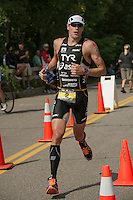 Andy Potts comes into Ellacoya for the half way mark of his 13 mile run during the Ironman 70.3 Timberman Triathlon on Sunday.  (Karen Bobotas/for the Laconia Daily Sun)