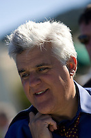 """PEBBLE BEACH, CA - AUGUST 19: Late night television talk show host Jay Leno looks at a 1921 Mercedes """"Chitty Bang Bang II"""" Tourer at the 2007 Pebble Beach Concours d'Elegance on August 19, 2007 in Pebble Beach, California.  (Photo by David Paul Morris)"""