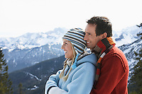 Couple embracing on mountain peak side view