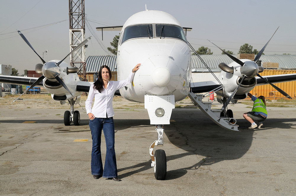 "Pilot, Danielle Aitchison, with the Beechcraft 1900D she flies in Afghanistan for The United Nations Humanitarian Air Service (UNHAS).   ...When asked about flying in a war zone, she says,  ""I'm just a normal average female.  My job is maybe a little different to some, but I have the same feminine side as other women.  I don't have any trouble going back to New Zealand relating to people.  I'm just a regular chick.""."