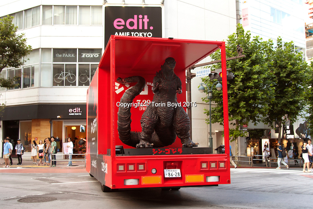 "July 24, 2016, Tokyo, Japan: This mobile advertising truck for ""Godzilla Resurgence"" (Japanese title ""Shin Godzilla"") was cruising the Shibuya district of Tokyo to promote the film's upcoming release on July 29, 2016. This latest Godzilla installment is the 29th by Toho Co. Ltd. which is co-directed by Hideaki Anno and Shinji Higuchi and stars actors Hiroki Hasegawa, Yutaka Takenouchi and actress Satomi Ishihara. The first Godzilla sci-fi classic was released by Toho in 1954, but in 2004 the studio announced an end to the film series. Then in 2014, on the 60th anniversary of Godzilla film franchise, Toho announced production of a Godzilla ""reboot"", slated for release in 2016. (Torin Boyd/Polaris)."