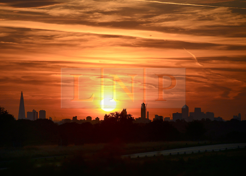 © Licensed to London News Pictures. 18/08/2012. Richmond, UK An early morning sunrise, seen from Richmond Park, over the skyline of London on Saturday 18 August 2012 as the UK's capital city prepares itself for temperatures of over 30 degrees celsius in what is expected to be one of the hottest August weekends on record. Photo credit : Stephen Simpson/LNP