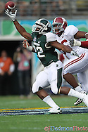Michigan State Spartans running back Larry Caper (22) just cant quite reach the catch as Alabama Crimson Tide linebacker Chris Jordan (36) and Alabama Crimson Tide defensive tackle Josh Chapman (99) pursue. Alabama leads at halftime 28-0.