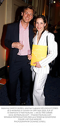 Ballerina DARCEY BUSSELL and her husband MR ANGUS FORBES, at a reception in London on 24th April 2003.	PJA 37