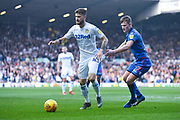 Mateusz Klich of Leeds United (43) has his shorts tugged by Callum Connolly of Bolton Wanderers (17) during the EFL Sky Bet Championship match between Leeds United and Bolton Wanderers at Elland Road, Leeds, England on 23 February 2019.