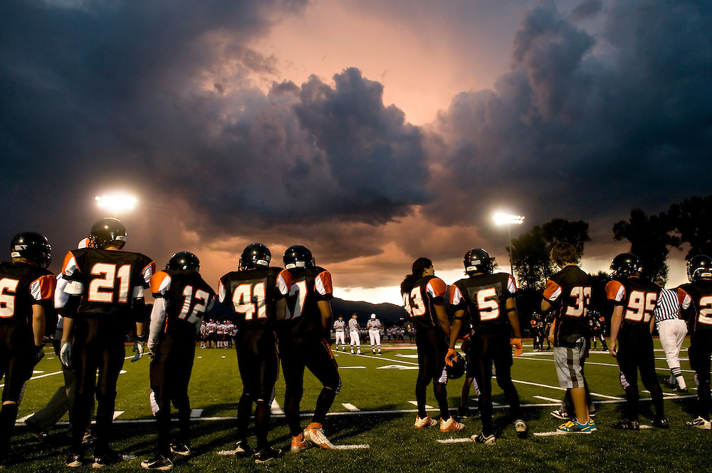 NEWS&GUIDE PHOTO / PRICE CHAMBERS.A spectacular sunset illuminates clouds over the Jackson Hole High School football game on Friday, as the Broncs take on Rawlins during their homecoming matchup. With poetic drama looming in the sky, Jackson won the game 41-14.