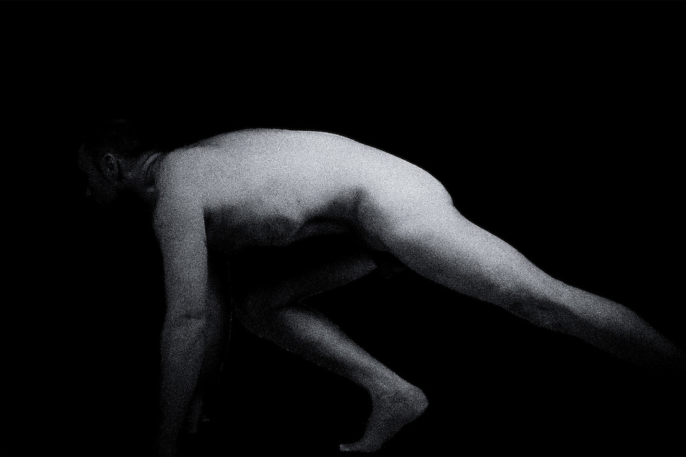 Black and white photo of a nude performing classic  poses.