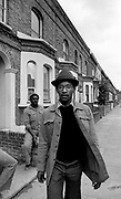Photo of Linton Kwesi Johnson (LKJ) on Railton Road Brixton - Race Today office 1979