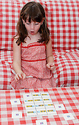 Young preschool girl of 5 learns arithmetic surprised by the results