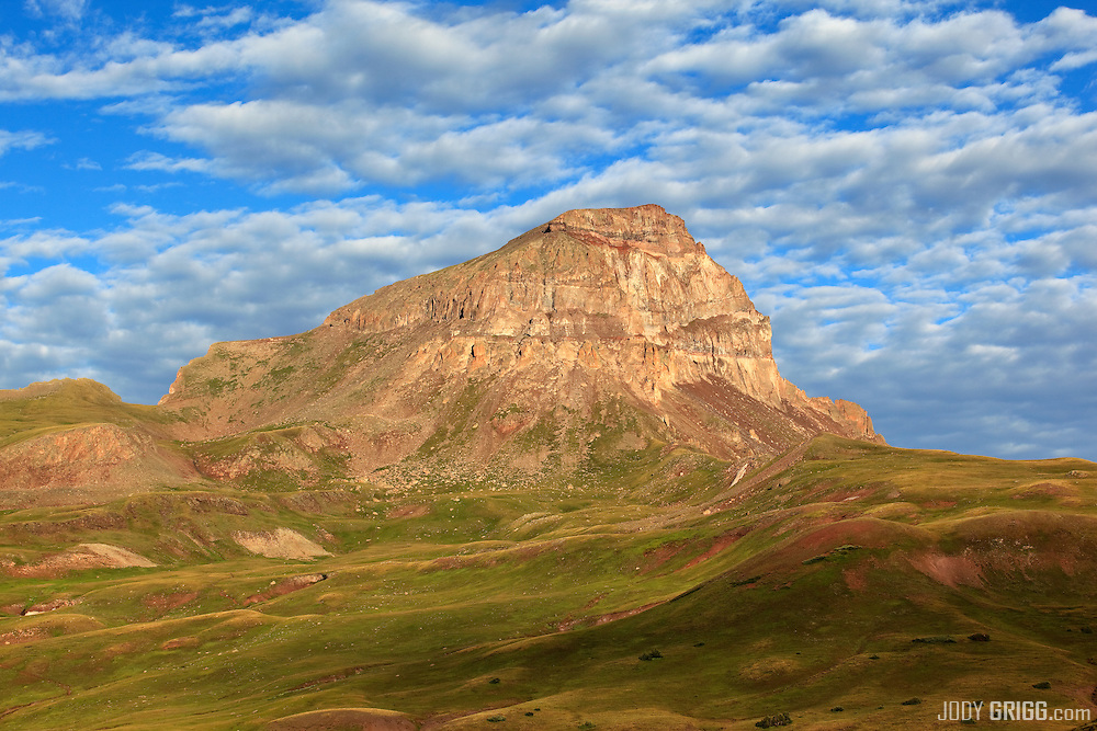 Buttermilk clouds cover the sky above Uncompahgre Peak near Lake City, Colorado.