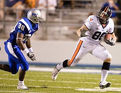 "Virginia tight end Jonathan Stupar (88) delivers a stiff arm to Middle Tennessee State linebacker Cam Robinson (30)..The Virginia Cavaliers football team defeated Middle Tennessee State Blue Raiders 23-21 at Johnny ""Red"" Floyd Stadium  in Murfreesboro, TN on October 6, 2007."