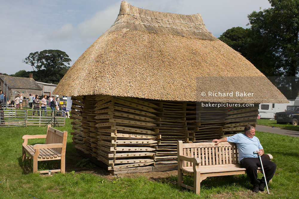 The Priddy Sheep hurdle stack shelter at the Priddy Sheep Fair. Moved from Wells in 1348 because of the Black Death, evidence has been found of a Fair being held at Priddy before that. There is a local legend, which says that as long as the hurdle stack remains in the village, so will the Fair. The Fair is held on the nearest Wednesday to 21st August, although originally it was held on the feast of St Lawrence the Martyr on the10th August. The fair has been continuously held every year since 1348, apart from the recent 2001 and 2007 foot -and-mouth epidemic years.
