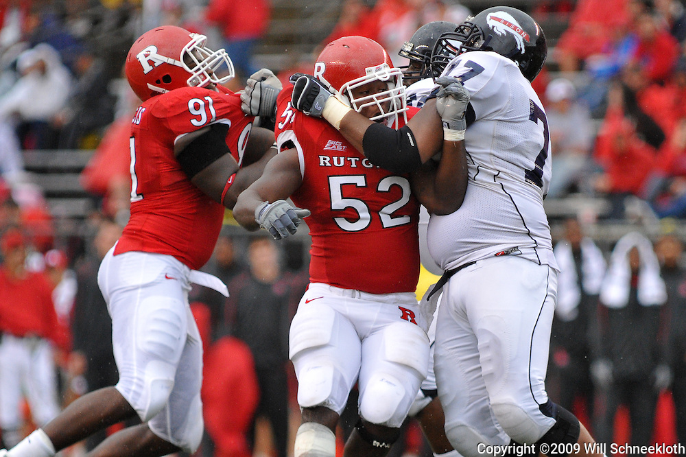 Sep 12, 2009; Piscataway, NJ, USA; Rutgers defensive end Eric Legrand (52) battles Howard offensive lineman Sean Woolford (77)  during the first half of Rutgers' 45-7 victory over Howard in NCAA College Football at Rutgers Stadium.