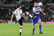Derby County midfielder Ikechi Anya (8) challenges Ipswich Town midfielder Jonathan Douglas (22) with a high foot during the EFL Sky Bet Championship match between Derby County and Ipswich Town at the iPro Stadium, Derby, England on 13 September 2016. Photo by Aaron  Lupton.