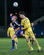 Jordan Burrow (Halifax) gets a header, flicking on in the final few moments of the game, trying to get Halifax the winner during the Conference Premier League match between FC Halifax Town and Guiseley at the Shay, Halifax, United Kingdom on 5 December 2015. Photo by Mark P Doherty.