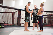 UFC welterweight Kyle Noke of Australia and UFC bantamweight Holly Holm of Albuquerque, New Mexico work with coach Mike Winkeljohn at Jackson Wink MMA in Albuquerque, New Mexico on June 10, 2016.