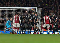 Football - 2017 / 2018 Premier League - Arsenal vs. Manchester United<br /> <br /> Mesut Ozil (Arsenal FC) lifts his free kick over the Manchester United wall at The Emirates.<br /> <br /> COLORSPORT/DANIEL BEARHAM