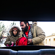 With winter looming a refugee family from Iran load up a car with their belongings as they wait to be taken near the Macedonian boarder in Thessaloniki as he and many others wait for the next stages in their migration into Europe.