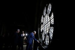 The Prince of Wales points as he looks at works taking place beside a window, flanked by the Dean of Westminster John Hall (left) during his visit to the The Queen's Diamond Jubilee Galleries at Westminster Abbey in London.