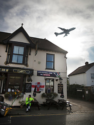 "© Licensed to London News Pictures. 27/10/2016. London, UK. A British Airways 747 takes off from Heathrow airport over the village of Longford. The government has announced that a third runway will be built at the United Kingdom's busiest airport. The Cabinet are divided - with Foreign Secretary Boris Johnson saying that the project is ""undeliverable"". Conservative MP for Richmond Zac Goldsmith has resigned. Photo credit: Peter Macdiarmid/LNP"