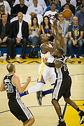Golden State Warriors forward Kevin Durant (35) is fouled during a lay up against the San Antonio Spurs at Oracle Arena in Oakland, Calif., on October 25, 2016. (Stan Olszewski/Special to S.F. Examiner)