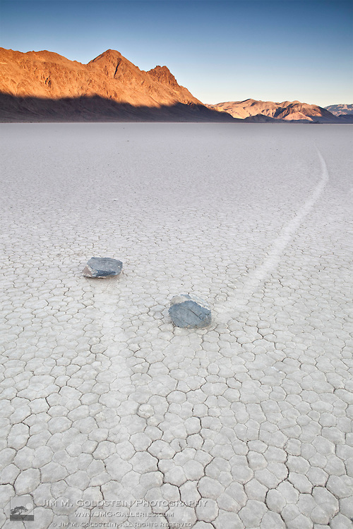 Two rocks nearly intersect on the Racetrack play in Death Valley National Park, California