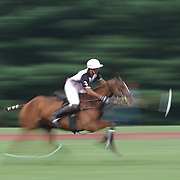 Matias Magrini, K.I.G. in action during the White Birch Vs K.I.G Polo match in the Butler Handicap Tournament match at the Greenwich Polo Club. White Birch won the game 11-8. Greenwich Polo Club,  Greenwich, Connecticut, USA. 12th July 2015. Photo Tim Clayton
