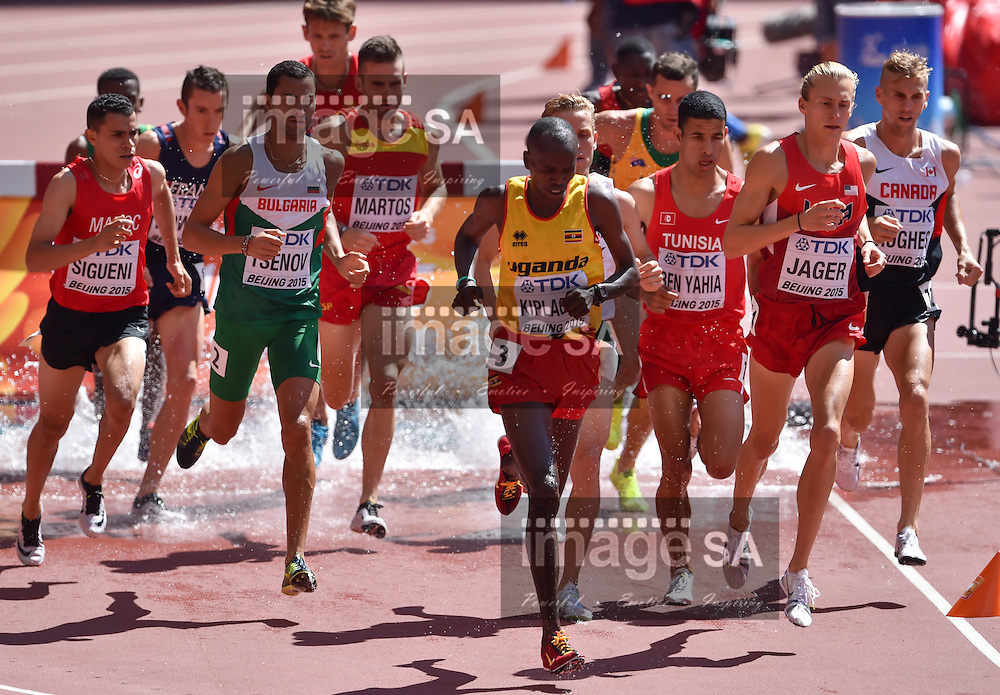 BEIJING, CHINA - AUGUST 22: Benjamin Kiplagat (Uganda) leads the field made up of Hicham Sigueni (Morocco), Mitko Tsenov (Bulgaria), Amor Ben Yahia (Tunisia), Evan Jager (USA) and Matthew Hughes (Canada) in Round 1 of the mens 3000m steeplechase during day 1 of the 2015 IAAF World Championships at National Stadium on August 22, 2015 in Beijing, China. (Photo by Roger Sedres/Gallo Images)