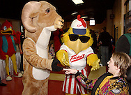 (from left) Robin from Red Robin looks on as the Trotwood High School Ram and the Frickers Frickin' Chicken greet a fan before the Dayton Gems take on the Flint Generals at Hara Arena, Sunday, November 22, 2009.