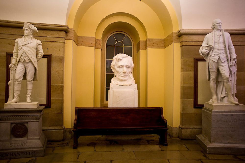 Washington, DC - After leaving the Capitol Hill Visitors' Center, tourists are taken to the crypt in the Capitol where a bust of Abraham Lincoln stands among statues of other famous Americans..Photo by Susana Raab