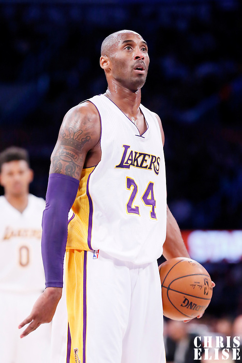23 November 2014: Los Angeles Lakers guard Kobe Bryant (24) is seen at the free throw line during the Denver Nuggets 101-94 overtime victory over the Los Angeles Lakers, at the Staples Center, Los Angeles, California, USA.