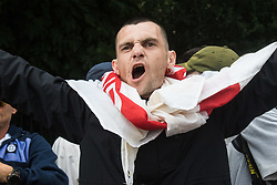 London, June 24th 2017. Anti-fascist protesters counter demonstrate against a march to Parliament by the far right anti-Islamist English Defence League. PICTURED: A member of the EDL chants slogans.