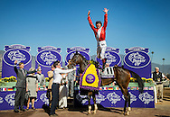 """ARCADIA, CA - NOVEMBER 05: Frankie Dettori does his patented """"Flying Dismount"""" after winning the Breeders' Cup Filly & Mare Turf during day two of the 2016 Breeders' Cup World Championships at Santa Anita Park on November 5, 2016 in Arcadia, California. (Photo by Alex Evers/Eclipse Sportswire/Breeders Cup)"""