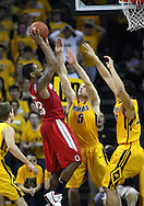 January 27, 2010: Ohio State guard/forward David Lighty (23) puts up a shot over Iowa guard Matt Gatens (5) and Iowa forward Aaron Fuller (24) during the second half of their game at Carver-Hawkeye Arena in Iowa City, Iowa on January 27, 2010. Ohio State defeated Iowa 65-57.