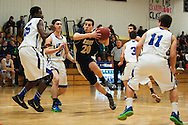 Essex's T.J. Reed (20) drives to the hoop during the boys basketball game between the Essex Hornets and the Colchester Lakers at Colchester High School on Tuesday night December 15, 2015 in Colchester. (BRIAN JENKINS/for the FREE PRESS)