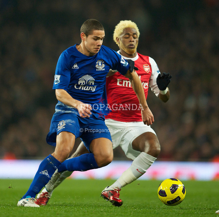 LONDON, ENGLAND - Tuesday, February 1, 2011: Everton's Jack Rodwell and Arsenal's Alexandre Song Billong during the Premiership match at the Emirates Stadium. (Photo by David Rawcliffe/Propaganda)