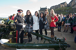 Miss Scotland Jennifer Reochs after firing of the One O'clock gun with Gunner Jamie Shannon. With Miss Northern Ireland Finola Frances Guinnane, Miss Wales Sara Jessica Manchipp, Miss Ireland Holly Carpenter and Miss England Alize Lily Mounter.The Miss World participants visit Edinburgh Castle and will witness the firing of the One O'clock gun..MISS WORLD 2011 VISITS SCOTLAND..Pic © Michael Schofield.