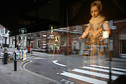 Reflections of Tudor royalty including King Henry the VIII and Jane Seymour appear as ghostly apparitions on a street corner in London's Mayfair. An art gallery exhibition of Tudor portraits, includes a striking picture of an unknown child seen far right who appears to be crossing a zebra-crossing. It looks like a girl but is in fact a young boy of about nine years of age, confusing our perception of gender in the middle-ages. Also, a white traffic direction arrow points around the road's corner as if indicating the location of Queen Jane. They all float just above ground level maiking an eerie and mystical image.