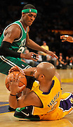Rajon Rondo and Derek Fisher scrap for the ball in the first half. The Lakers defeated the Boston Celtics in game 6 of the NBA Finals 89-67. Los Angeles, CA 06/15/2010 (John McCoy/Staff Photographer).